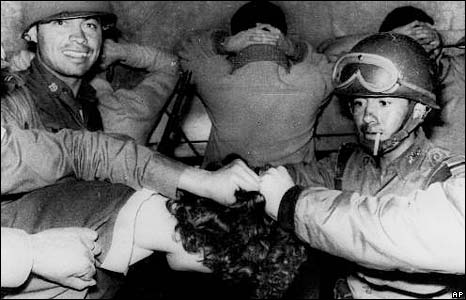 As the security forces continued the crackdown, the government said some 30 people, including police officers, had died, which was grossly inaccurate, basically beginning the government's cover-up which lasted decades. Here soldiers are cutting protesters' hair.