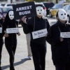 Thumbnail image for Masked protesters call for George Bush's arrest for war crimes as he opens his presidential library.