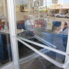 Thumbnail image for Scores of Windows and Glass Doors Etched Along Newport by Vandals