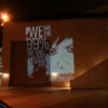 """Thumbnail image for The 'Bat Signal' – """"Projection Bombing"""" by Occupy San Diegans at Convention Center and Other Public Buildings"""