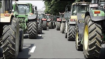 Belgian farmers drive their tractors into Brussels on Wednesday June 18, 2008. Hundreds of farmers, truckers and taxi drivers blocked roads into the center of Brussels on the eve of an EU summit to push leaders for help coping with skyrocketing fuel prices. (AP Photo/Virginia Mayo)