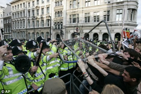 Police confronted hundreds of protesters as they pushed against security barriers