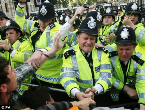 Police and protesters clash during anti-Bush demonstrations in Parliament Square, central London