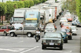 Slow Moving Trucks Blocked Traffic to Protest Gas Prices in Costa Rica.