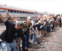 """Crowds continue tradition for 29th year of """"mooning"""" passing trains outside a Laguna Niguel bar. (Photo: Mugs Away Saloon)"""