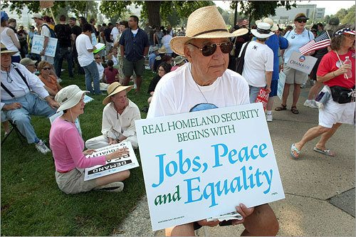 Don O'Brien from St. Paul held a sign outside the state capital. (John Tlumacki / Globe Staff)