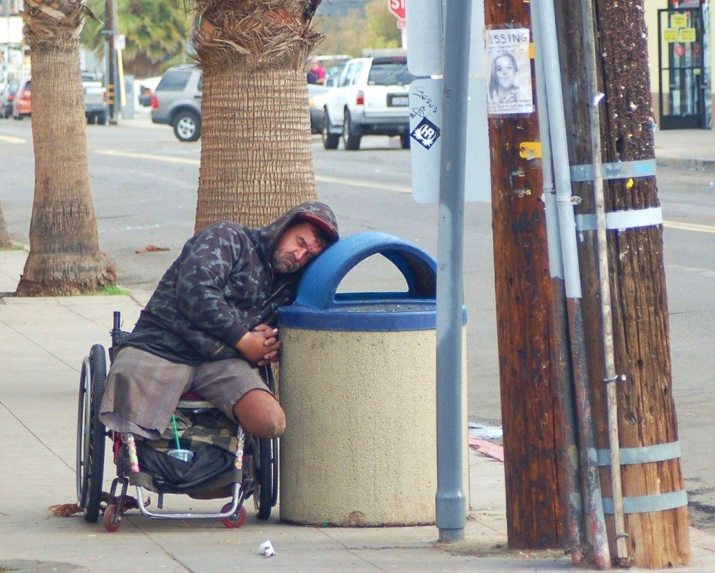 Homeless guy on trashcan