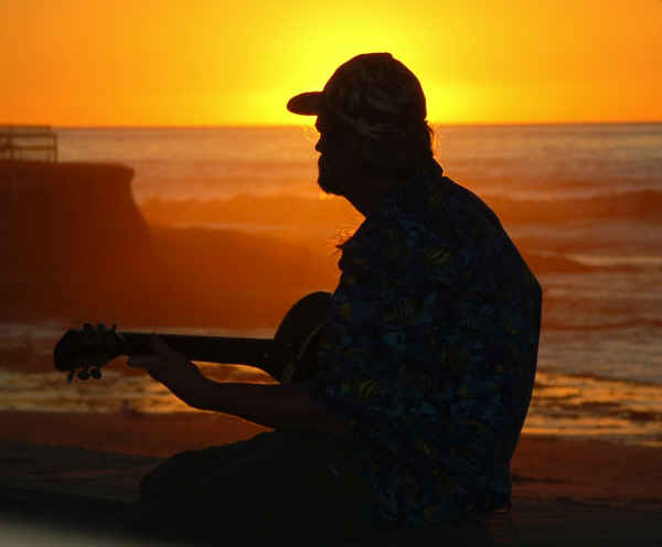 guy guitar pier sunset-sm