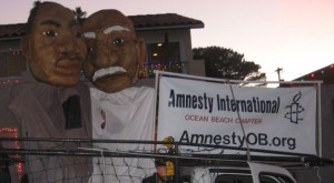 Giant Puppets: Duane Anderson as Martin Luther King and Mary Lydon as Ghandi